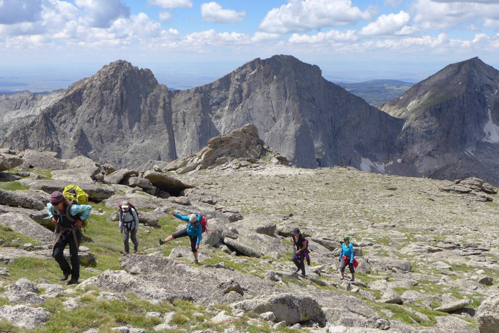 A group of backpackers hikes uphill in the Brooks Range of Alaska