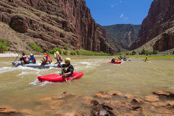 Group of NOLS students kayaking in Utah