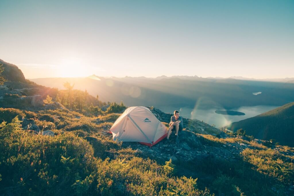 Camping in a tent in the outdoors