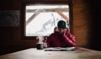 Bridget Grove studies up in Keith's Hut near Pemberton, B.C. [Photo] Garrett Grove