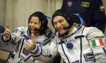US astronaut Cady Coleman (L) and Italian astronaut Paolo Nespoli (R) photo by DMITRY KOSTYUKOV/AFP/Getty Images)