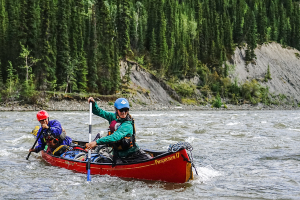 NOLS summer semester participants paddle a whitewater canoe in the Yukon