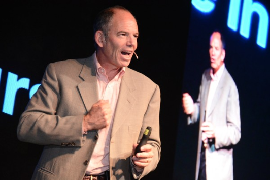 Netflix co-founder Marc Randolph onstage giving a presentation