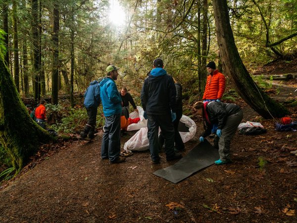 NOLS Wilderness Medicine students practice caring for a patient in the woods