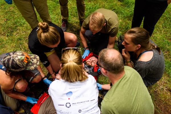 NOLS Wilderness Medicine students care for a patient in a practice scenario