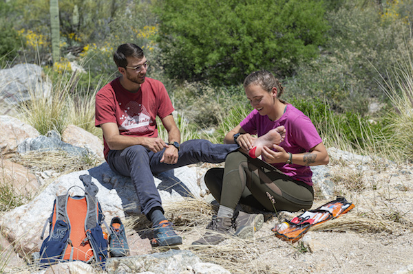NOLS Wilderness Medicine student practices treating a fellow students foot injury