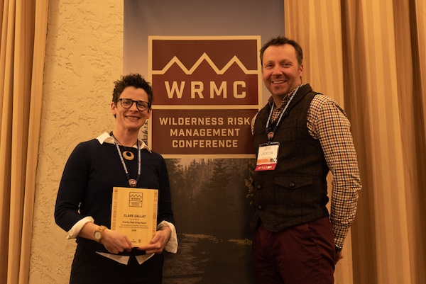 Clare Dallat holding Reb Gregg award with Jeff Jackson at 2018 Wilderness Risk Management Conference