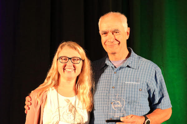 Joe Austin at 2018 Association for Experiential Education conference holding his Servant Leader Award