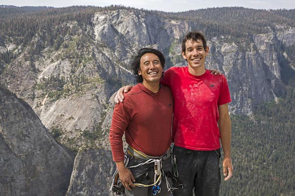 Jimmy Chin and Alex Honnold smile together during filming of Free Solo